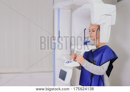 Woman Patient Doing Panoramic Teeth X-ray