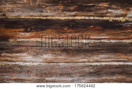 The old log wall of the village house, the tow