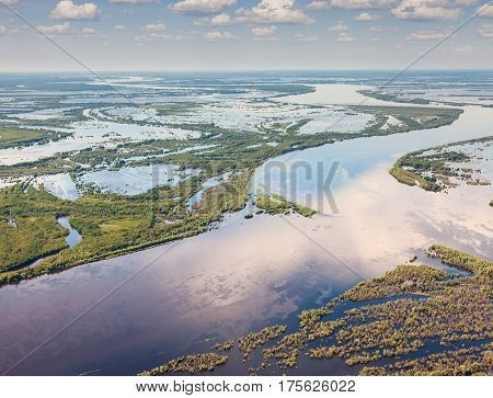 Aerial view of floodland of great river during summer.