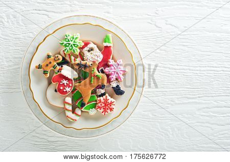 Delicious homemade christmas cookies plated on a white background.