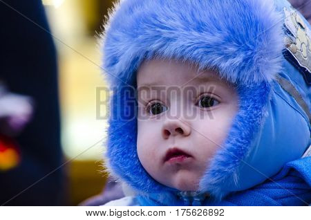 Portrait of little boy in winter time