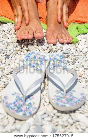 female feet beach flip flops summer woman tan