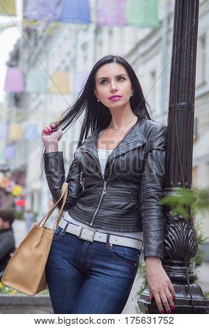 Beautiful brunette woman in the street on a walk