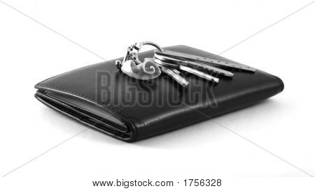 Purse With Keys On A White Background