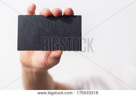 Business Man, Guy, Designer, Freelancer Handing A  Parchment Visiting  Blank Black Business Card, Wh