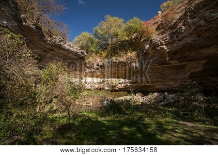 Landscape with waterfall on the rocks. Natural waterfall.
