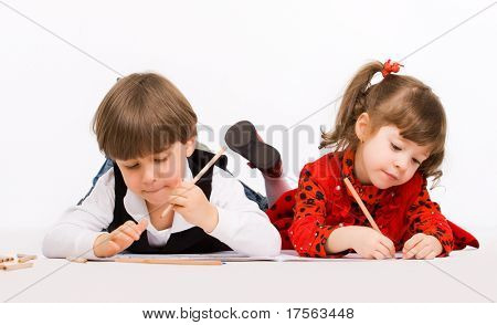 Children drawing with pencils over white