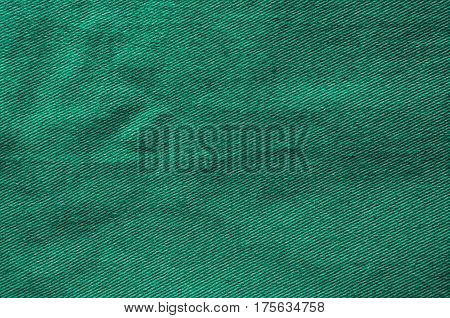 Green fabric background. Cloth texture as blank backdrop