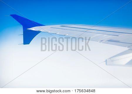 sky as seen through window of an aircraft