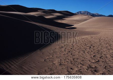 Shadows and sand drifts adorn the hills of the Great Sand Dunes National Park in southern Colorado near Alamosa