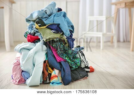 Pile of colorful clothes on floor indoors