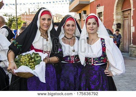 QUARTU S.E., ITALY - September 15, 2012: Parade of the Wine Festival 2012 - group of beautiful girls in traditional Sardinian costume - Sardinia