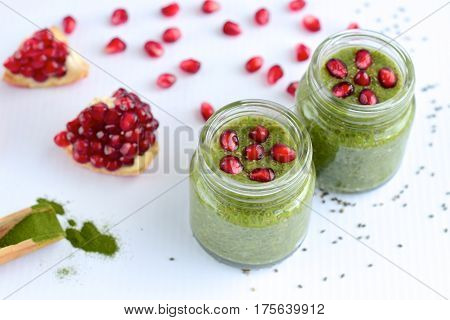Matcha green tea chia pudding with pomegranate arils