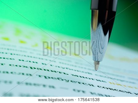 Pen on a opened book. Macro image. library education literature a surge of knowledge