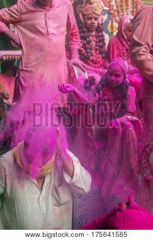 Vrindavan, India. March 19, 2016. Colourful Holi procession on the streets of Vrindavan, Uttar Pradesh, India.