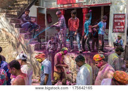 Barsana, India - March 17, 2016: Kids celebrate Lathmar Holi in Barsana village, Uttar Pradesh, India.