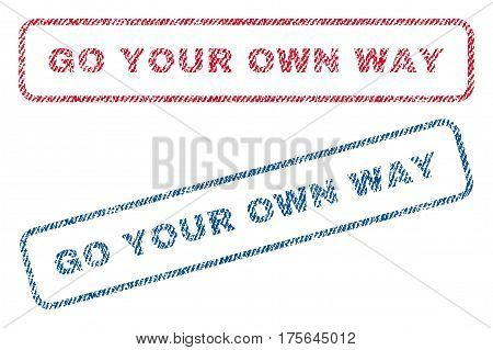 Go Your Own Way text textile seal stamp watermarks. Blue, red fabric vectorized texture. Vector tag inside rounded rectangular banner. Rubber sign with fiber textile structure.