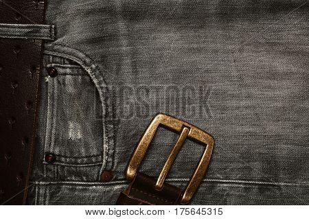 Black jeans, denim texture, waist belt with buckle, background