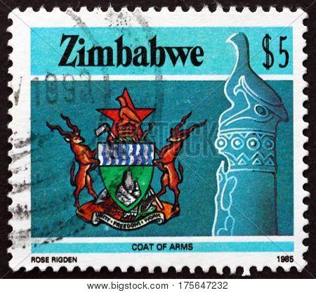 ZIMBABWE - CIRCA 1985: a stamp printed in Zimbabwe shows Zimbabwe bird and national coat of arms circa 1985