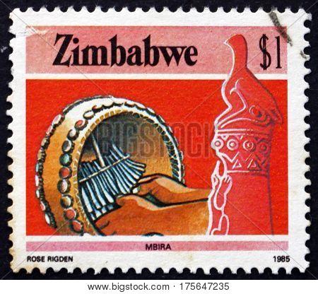 ZIMBABWE - CIRCA 1985: a stamp printed in Zimbabwe shows Zimbabwe bird and mbira drum musical instrument circa 1985