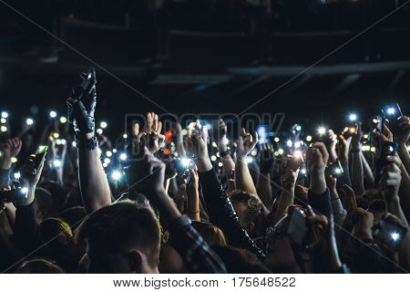 People Taking Photographs With Smart Phone During A Music Concert. Person Capturing A Video On A Mob