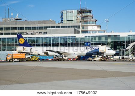 FRANKFURT, GERMANY - JAN 20th, 2017: Aircrafts, an Airbus from Lufthansa, at the gate in Terminal 1 at Frankfurt International Airport FRA. Terminal 1 was completed in 1972 and houses Lufthansa and other Star Alliance partners.