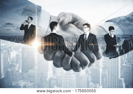 Handsome businessmen shaking hands on modern city background. Contract concept. Double exposure