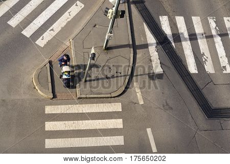 Prague, Czech Republic - March 3: Bird's Eye View Of Woman With Kid In Baby Carriage Waiting On Inte
