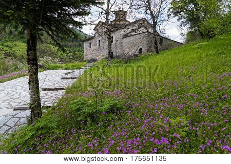 Vernal landscape with raditional stone church in Thessaly, Greece