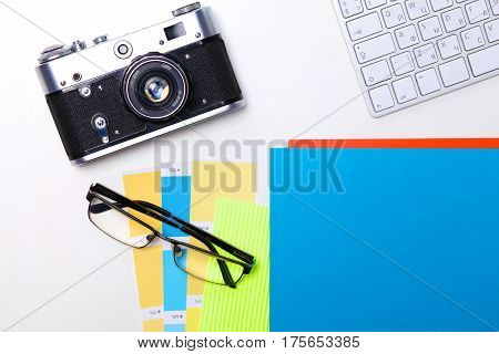 Top view of office graphic design pen mouse with laptop wireless mouse and vintage old camera on whitetable. Concept graphic design workplace.