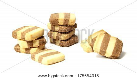 A batch of eleven vanilla and chocolate shortbread cookies isolated on a white background.