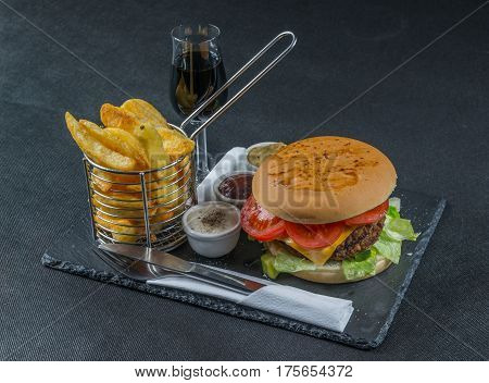 Right Side View On A Flame Grilled Double Stack Cheeseburger, Lettuce, Tomato, With Three Sauces, Ch