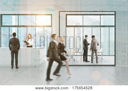 Side View Of People Walking Past Reception, City
