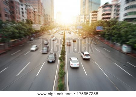 China Guangzhou evening sunset highway traffic skyline buildings