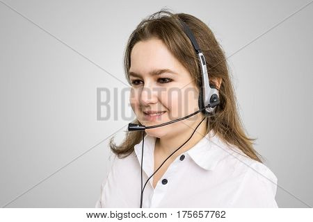 Telemarketing And Customer Service Concept. Young Smiling Woman
