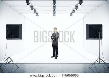 Attractive confident businessman in modern photo studio with professional lighting equipment. 3D Rendering