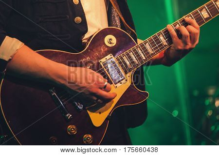 Electric Guitar Player On A Stage, Soft Focus