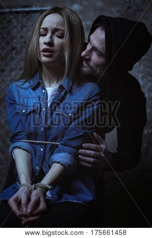 You cannot leave me. Crazy hateful evil criminal making sure the girl not escaping while cording her up to a chair