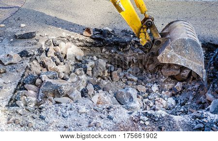 Working Excavator Tractor Digging on street city