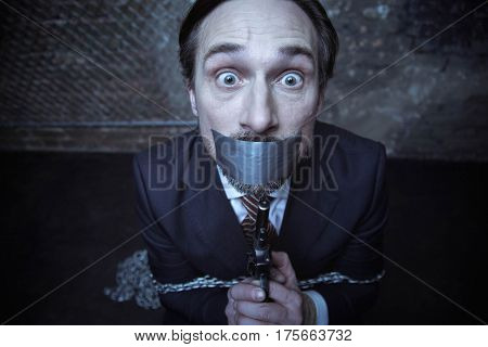 Get me outta here. Not very smart scared rich gentleman being kidnapped and held in some strange room while holding a gun and hoping getting away from there