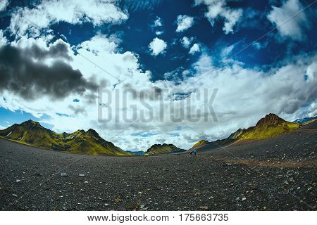 Travel to Iceland. Beautiful dramatic Icelandic landscape with mountains, sky and clouds. Trekking in national park Landmannalaugar. road in the Iceland.