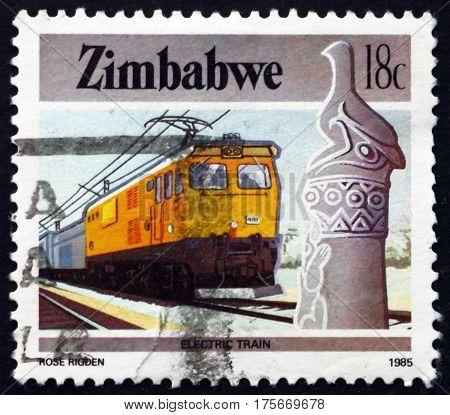 ZIMBABWE - CIRCA 1985: a stamp printed in Zimbabwe shows Zimbabwe bird and electric train circa 1985