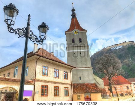 Traditional reformed church architecture and a lamp in Rasnov town - Romania