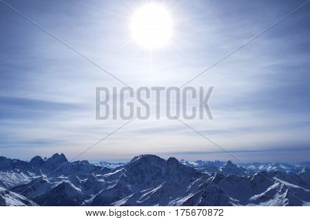 beautiful winter mountains with blue sky, snowy peaks. amazing scenic nature landscape. photo on the theme of mountains, nature, adventures, travel.