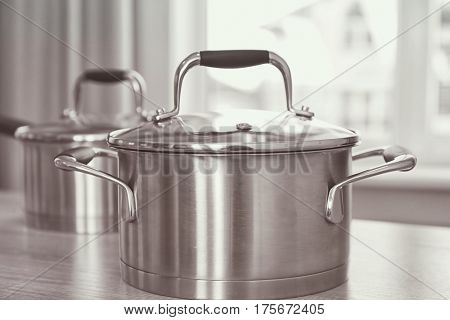Metal saucepan on table in kitchen