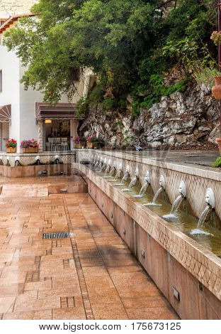 Old venetian fountain with lion heads springs pure drinking water in Spili Crete Greece