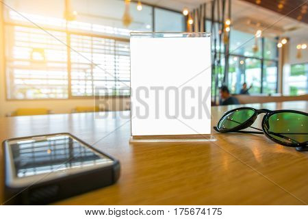 Table Tent with smart phone and glasses on the table