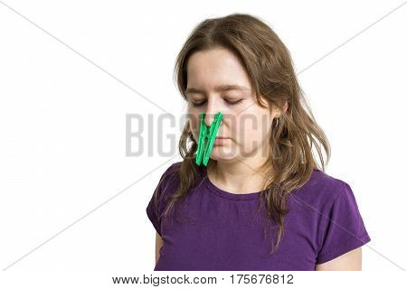 Pollen Allergy Concept. Young Woman Cant Breathe And Wearing Peg