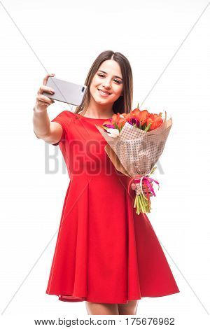 Smiling Girl Standing With A Bouquet Of Colored Tulips In Their Hands, Make Selfie Phone On White