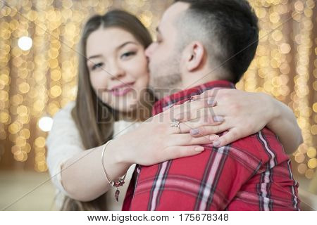 Young Future Parents On The Background Of Bright Lights Of Garlands.